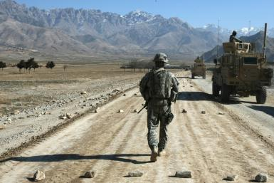 In this file photo a US soldier walks along a road under construction near Kabul on January 11, 2010
