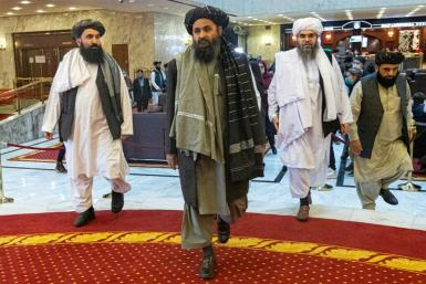 Taliban co-founder Mullah Abdul Ghani Baradar (C) has said the group remains committed to peace talks but that a 'genuine Islamic system' is the only way to end the war