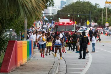 The driver of a pickup truck slammed into a crowd gathering for a Pride parade in Florida