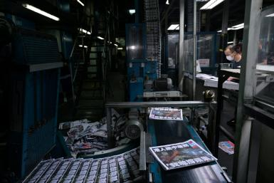 Apple Daily employees work in the printing room for the paper's last edition in Hong Kong early on June 24, 2021