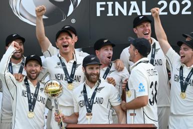 New Zealand's captain Kane Williamson (C) holds the winner's Mace as New Zealand players celebrate victory in the ICC World Test Championship Final against India in Southampton, England