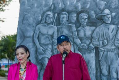 Nicaraguan President Daniel Ortega (R) and his wife Vice-President Rosario Murillo attend an anniversary ceremony for the birth of Sandinista leader Carlos Fonseca Amador in Managua on June 23, 2021