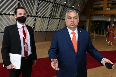 Hungary's Prime Minister Viktor Orban defended the controversial law as he arrived for the EU summit Thursday