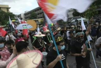 IMAGES Pro-democracy protesters call for the premier to resign as they march on the 89th anniversary of the Siamese Revolution -- an uprising that transformed Thailand from absolutism to a constitutional monarchy. They took to the streets despite warning