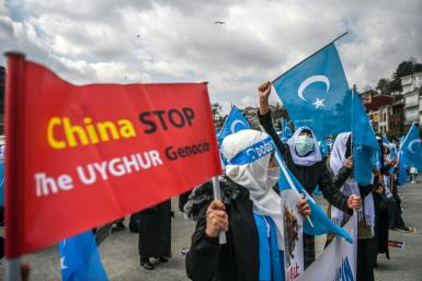 Ethnic Uyghur women demonstrate near the Chinese consulate in Istanbul over the treatment of Uyghurs in China's Xinjiang region