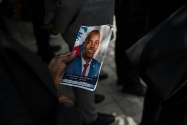 A photo of slain president Jovenel Moise is seen at a memorial ceremony in Port-au-Prince, one of several events leading up to the funeral in Cap-Haitien