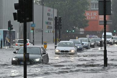 The Met Office issued an amber weather warning and said there was a risk of lightning strikes and flooding
