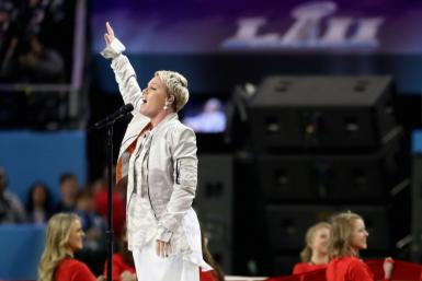 Pink singing the US national anthem at the Super Bowl in February 2018 in Minneapolis, Minnesota: she has offered to pay the fines slapped on the Norwegian women's beach handball team for wearing shorts instead of bikinis during a championship match