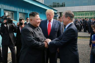 South Korean President Moon Jae-in (R) is credited with brokering the rapprochement between North Korea and the United States in 2018