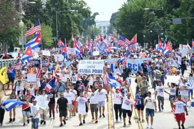 Demonstrators marching against and in favor of the Cuban government took to the streets around the world on the weekend