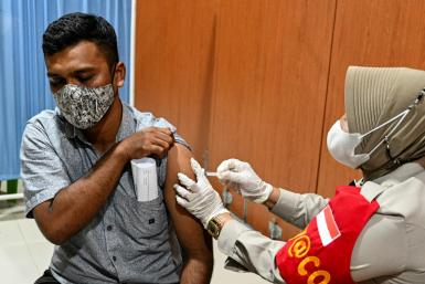 Indonesia's vaccination levels remain well below the government's one-million-a-day target for July