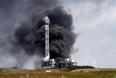 Smoke rises from a landfill and waste incineration area at the Chempark industrial park run by operator Currenta following an explosion in Leverkusen in western Germany, on July 27, 2021 At least 16 people were injured and five missing after an explosio