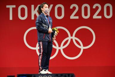 Taiwan's star weightlifter Kuo Hsing-chun won gold at the Tokyo Olympics, but there was no flag and no anthem to greet her