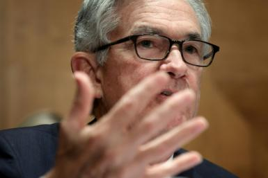 US Federal Reserve boss Jerome Powell said that while the world's top economy was well on the recovery track, it was too early to begin removing monetary policy support just yet