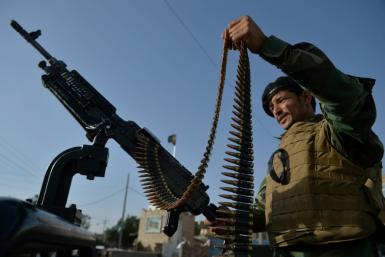 An Afghan soldier guards a checkpoint in Herat on July 28, 2021
