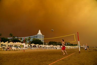 Dark smoke drifts over a hotel complex during a massive forest fire which engulfed a Mediterranean resort region on Turkey's southern coast near the town of Manavgat, on July 29, 2021