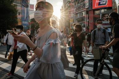 Japan is set to expand and extend a virus state of emergency one week into the Olympics