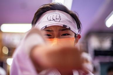 A student practises karate at a dojo in Tokyo