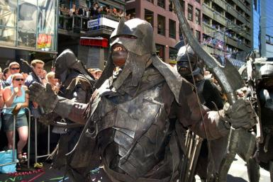 """Uruk-Hai warriors from the Lord of The Rings during the parade through the Wellington streets prior to the worldwide premier of the third and final Rings movie """"Return of The King"""", Wellington, New Zealand in December 2003"""