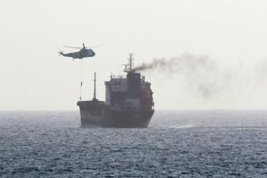 A handout image released by US Central Command in August 2020 reportedly shows Iranian forces boarding a tanker in international waters in the Gulf of Oman