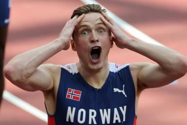 Norway's Karsten Warholm wiped a huge chunk off his own 400m hurdles world record to win Olympic gold