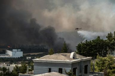 The blaze spread at the foot of Mount Parnitha with the fire service telling people to evacuate