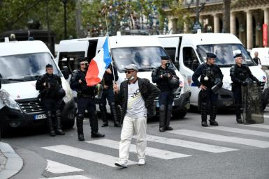 """Protesters in Paris on Thursday chanted slogans """"libery, liberty"""" and """"Macron, we don't want your pass"""""""