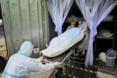 Thailand's morgue workers are battling exhaustion as the kingdom's latest Covid-19 wave hits new highs and the death toll mounts