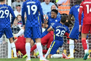 Chelsea's Reece James (centre) was sent-off for handling on the line