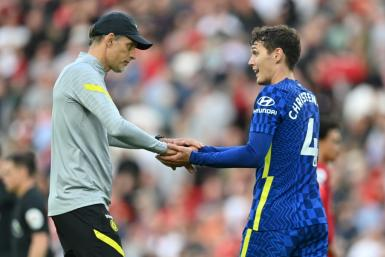 Thomas Tuchel (left)lauded Chelsea's resilience to hold out for a 1-1 draw at Liverpool with 10 men