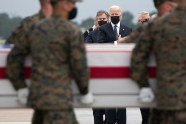 US President Joe Biden (C) attends the dignified transfer of the remains of service members killed during Kabul airport evacuation operatons at Dover Air Force Base in Dover, Delaware, on August, 29, 2021