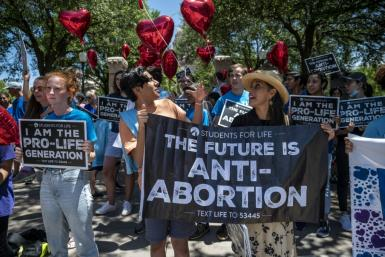 Abortion opponents protest in the state capitol in Texas, where a new restrictive law on ending pregnancies has taken effect