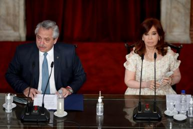 Argentina's President Alberto Fernandez and Vice President Cristina Kirchner, shown here in Buenos Aires in March 2021, are in a face-off after a recent electoral loss