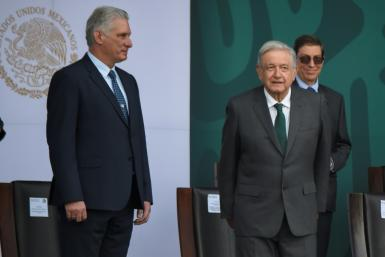 Cuban President Miguel Diaz-Canel (L) and Mexican President Andres Manuel Lopez Obrador attend a ceremony marking Mexico's independence, in Mexico City on September 16, 2021