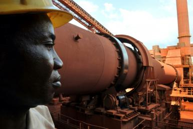 Guinea's coup leader met excutives from the extractive industries -- such as this bauxite plant