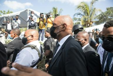 Haiti's Prime Minister Ariel Henry (C), seen here attending the funeral of slain President Jovenel Moïse on July 23, 2021, in Cap-Haitien, Haiti, fired a prosecutor who accused him of links to the killing