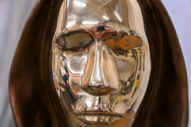 To reflect the mystery surrounding the true identity of bitcoin's founder, sculptors Tamas Gilly and Reka Gergely turned the face into a sort of mirror