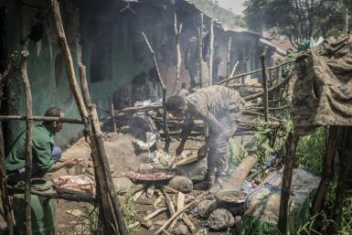 Ethiopian National Defence Force (ENDF) soldiers prepare food in their camp at an undisclosed location in Ethiopia, on September 16, 2021.