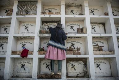 The remains of the Lucanamarca massacre victims lie in a white mausoleum in the local cemetery