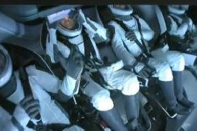 The first all-civilian crew to orbit the Earth, inside the SpaceX Dragon capsule