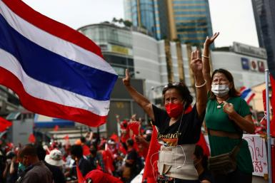 Hundreds of protesters drove through Bangkok's streets to mark the 15th anniversary of a military coup that ousted former premier Thaksin Shinawatra