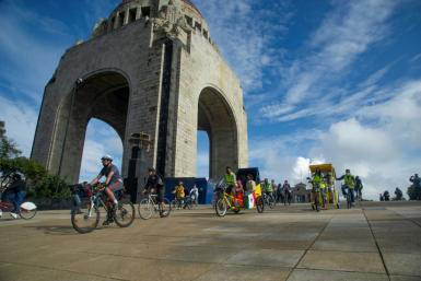 People take part in the bicycle ride 'Mexico las abraza' welcoming the young members from the Afghan robotics team who received asylum in Mexico City on September 19, 2021