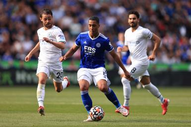 Youri Tielemans of Leicester City in action with Bernardo Silva and Ilkay Gundogan of Manchester City