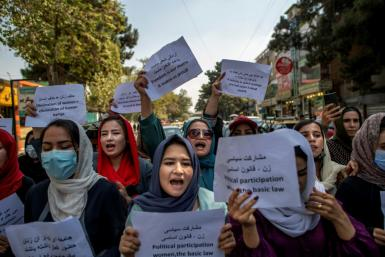 About a dozen Afghan women protested briefly Sunday outside the old Ministry for Women's Affairs, which has now been replaced by a department that earned notoriety for enforcing strict islamic doctrine