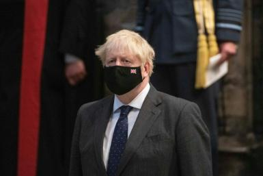 Britain's Prime Minister Boris Johnson wearing a protective face covering, attends a service of Thanksgiving and Rededication to commemorate the 81st Anniversary of the Battle of Britain at Westminster Abbey