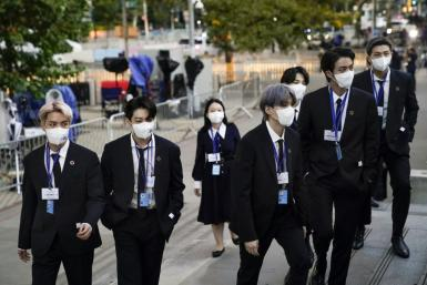 Members of the South Korean boy band BTS arrive at the United Nations headquarters to deliver remarks on development