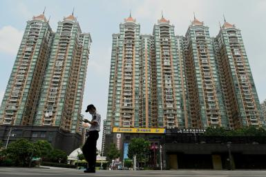 Chinese property developer Evergrande has admitted facing 'tremendous pressure' as it tackles a debt pile of more than $300 billion
