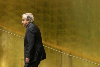United Nations Secretary-General Antonio Guterres walks to his desk during the annual General Assembly