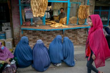Women in Kabul beg for bread following the takeover by the Taliban, which have stopped them from working