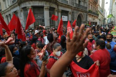 Activists from the Homeless Workers Movement protest outside the Sao Paulo stock exchange